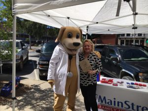 Woman and Mascot for MainStreet Family Urgent Care at downtown Eufaula farmers market